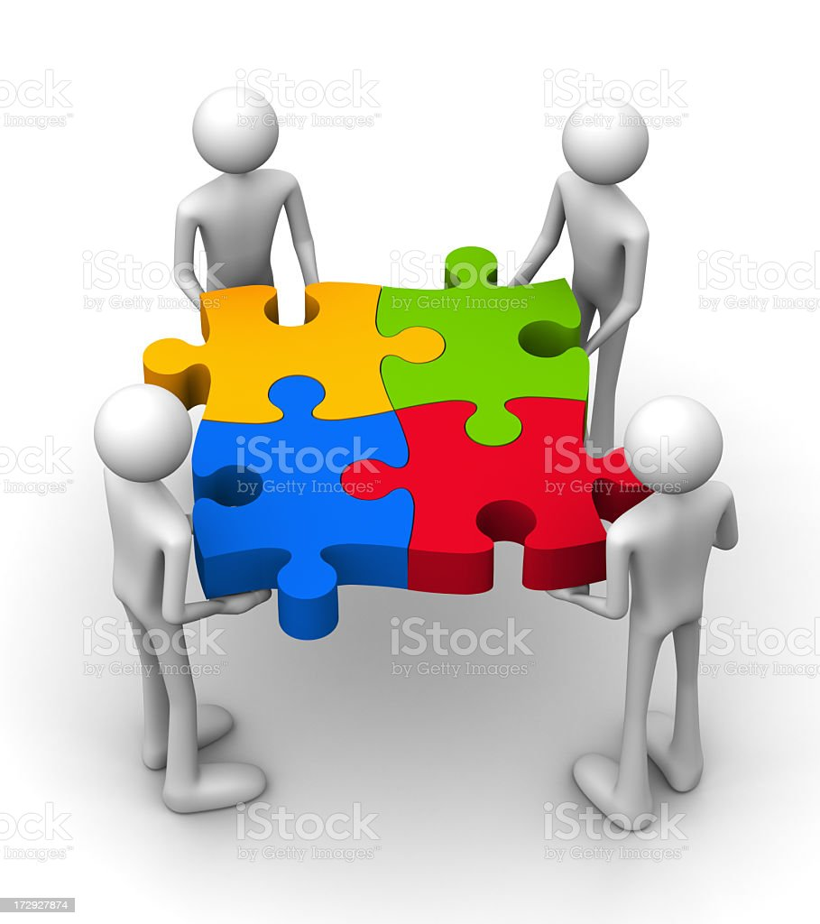 A graphic showing teamwork using a puzzle royalty-free stock photo