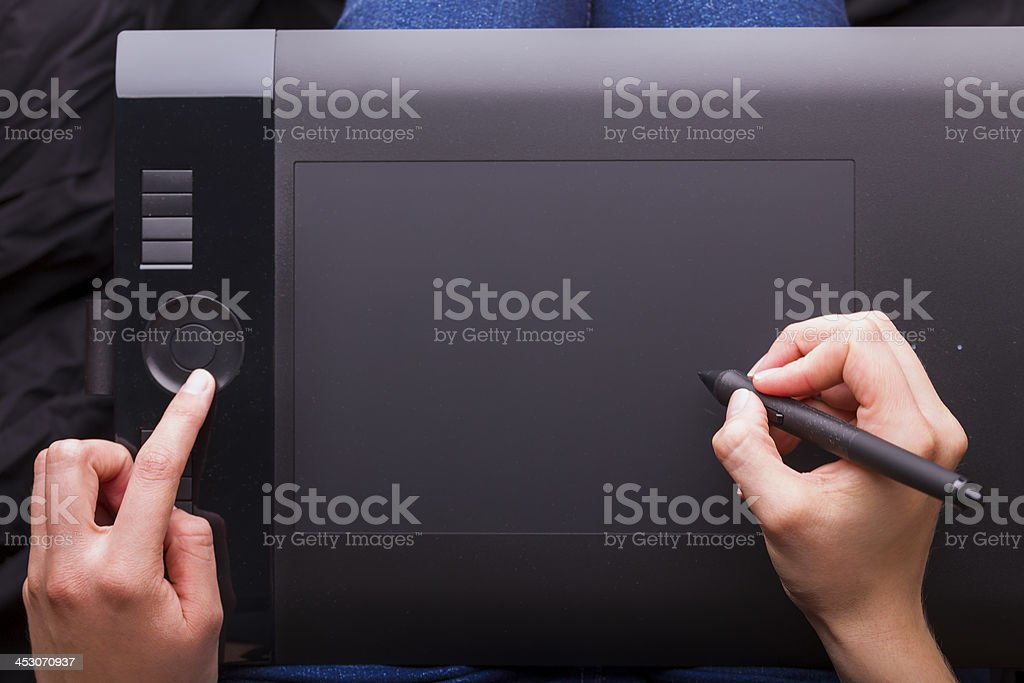 Graphic Tablet Being Used with a Pen by Female Hands stock photo