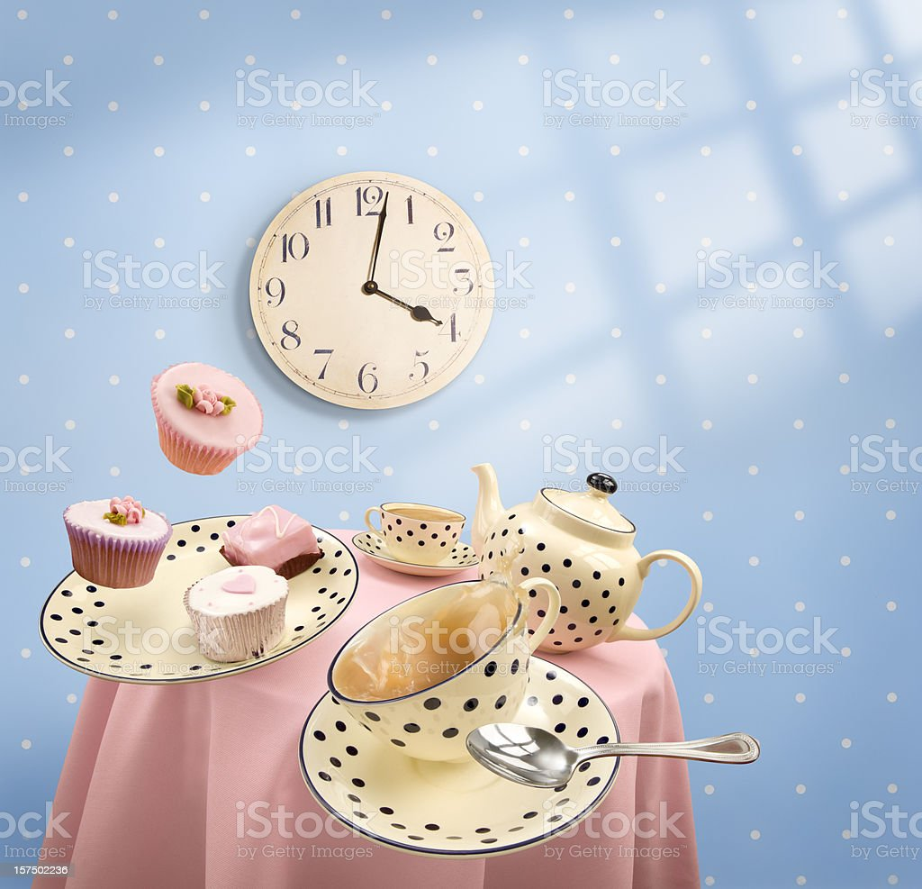 Graphics of tea-time with mugs and cakes flying off table stock photo