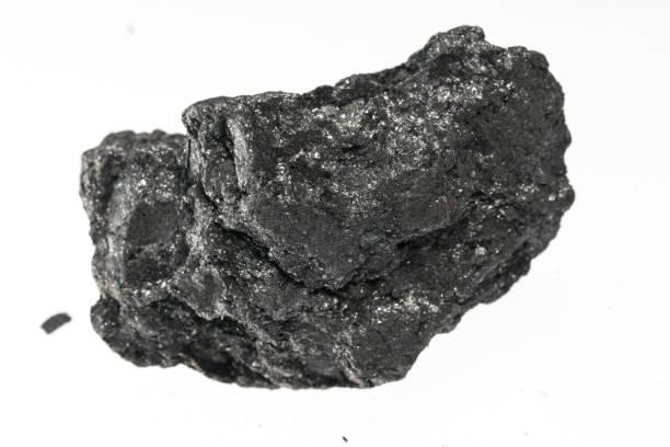 graphite mineral sample studio shot with white background - campione scientifico foto e immagini stock