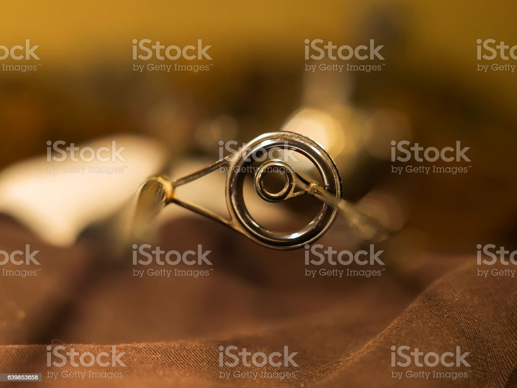 Graphite rings on the fishing rod closeup stock photo