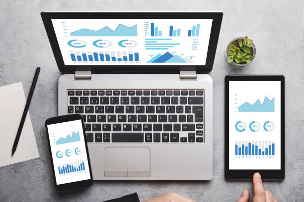 Graphs and charts elements on laptop, tablet and smartphone screen stock photo