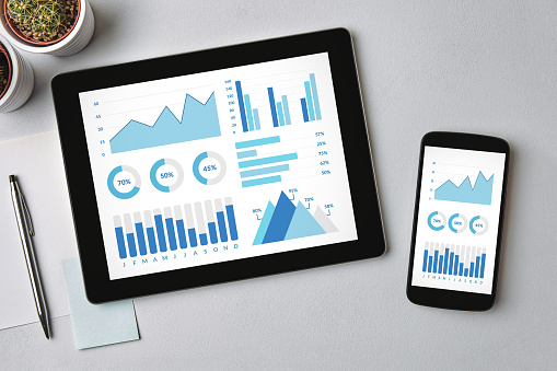 Graphs And Charts Elements On Tablet And Smartphone Screen Stock Photo - Download Image Now
