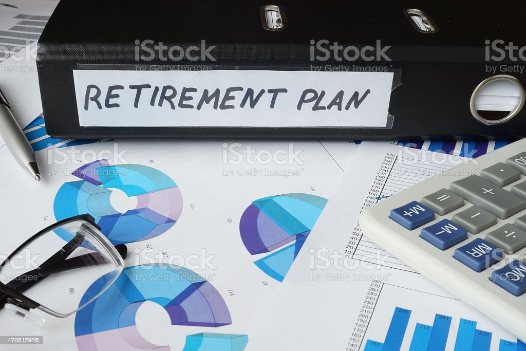 Graphs and file folder with label retirement plan. stock photo
