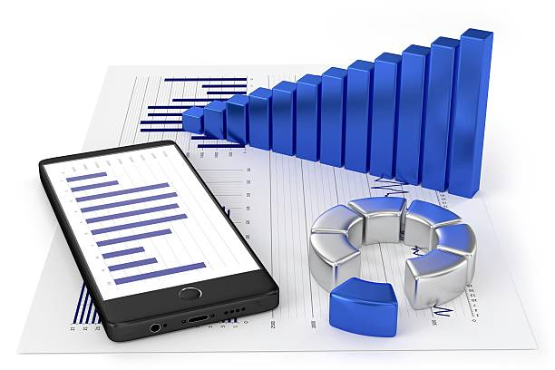 Graphs, charts and a smartphone stock photo