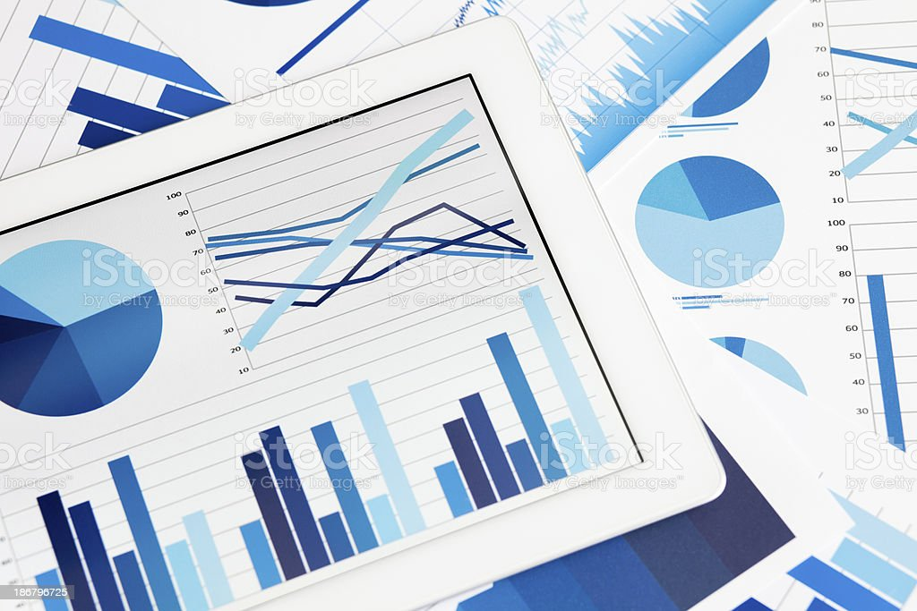 Graphs on digital tablet stock photo