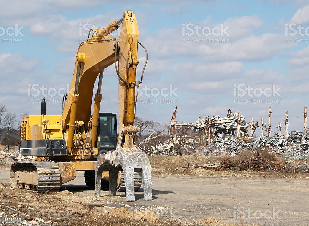 Grappler at demolition site royalty-free stock photo