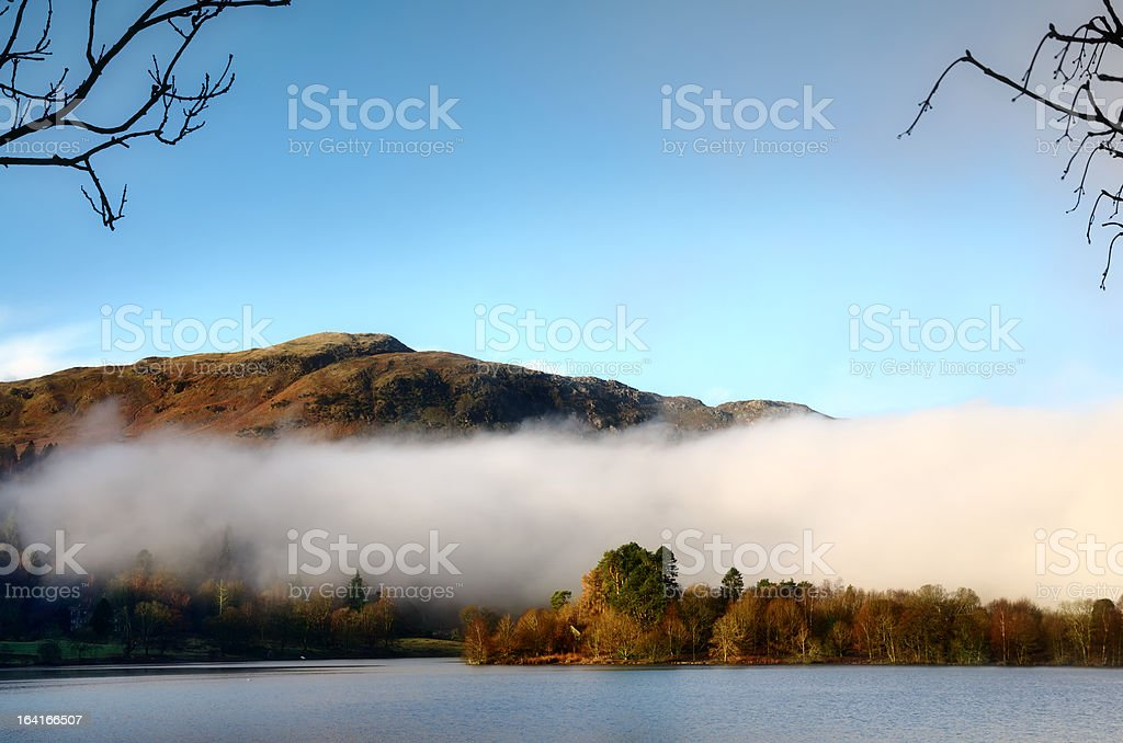Grasmere on a misty winter morning. stock photo