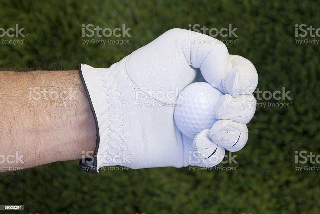 Grasping golf ball royalty-free stock photo