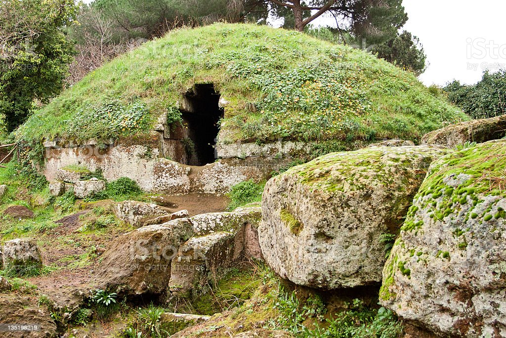 Grass covered circular tombs in Cerveteri stock photo