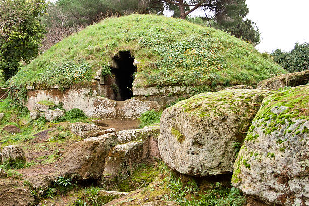Grass covered circular tombs in Cerveteri stock photo