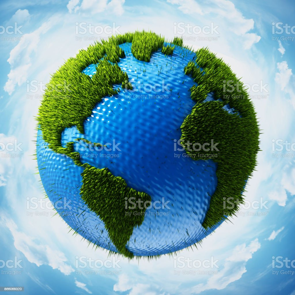 Grass covered globe with world map surrounded with blue sky stock photo