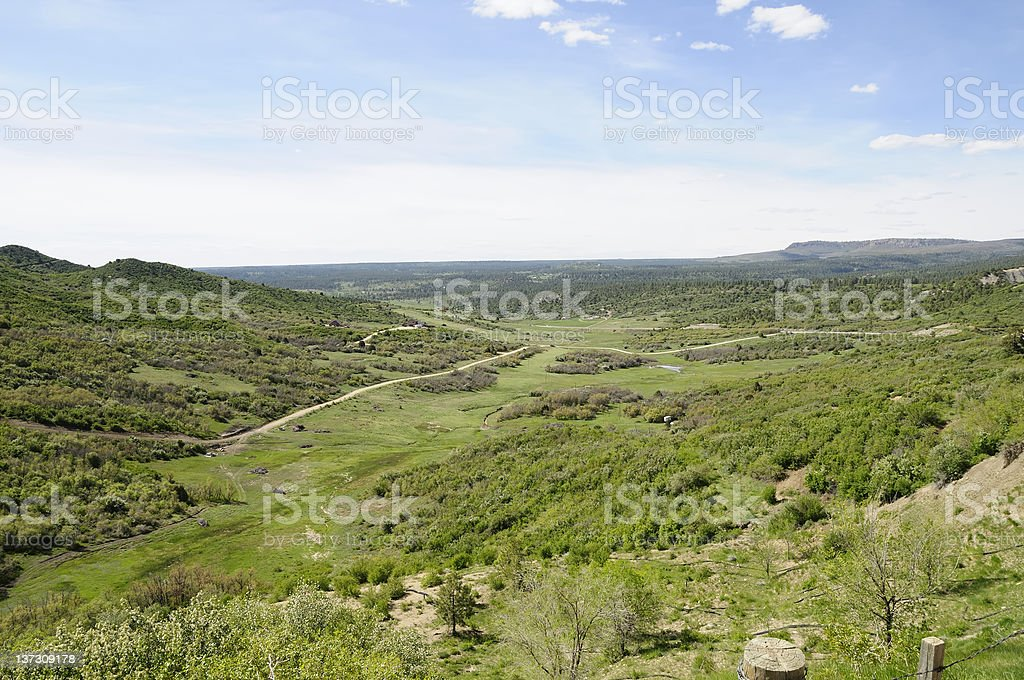 A grass covered rolling Colorado landscape under cloudy sky. royalty-free stock photo