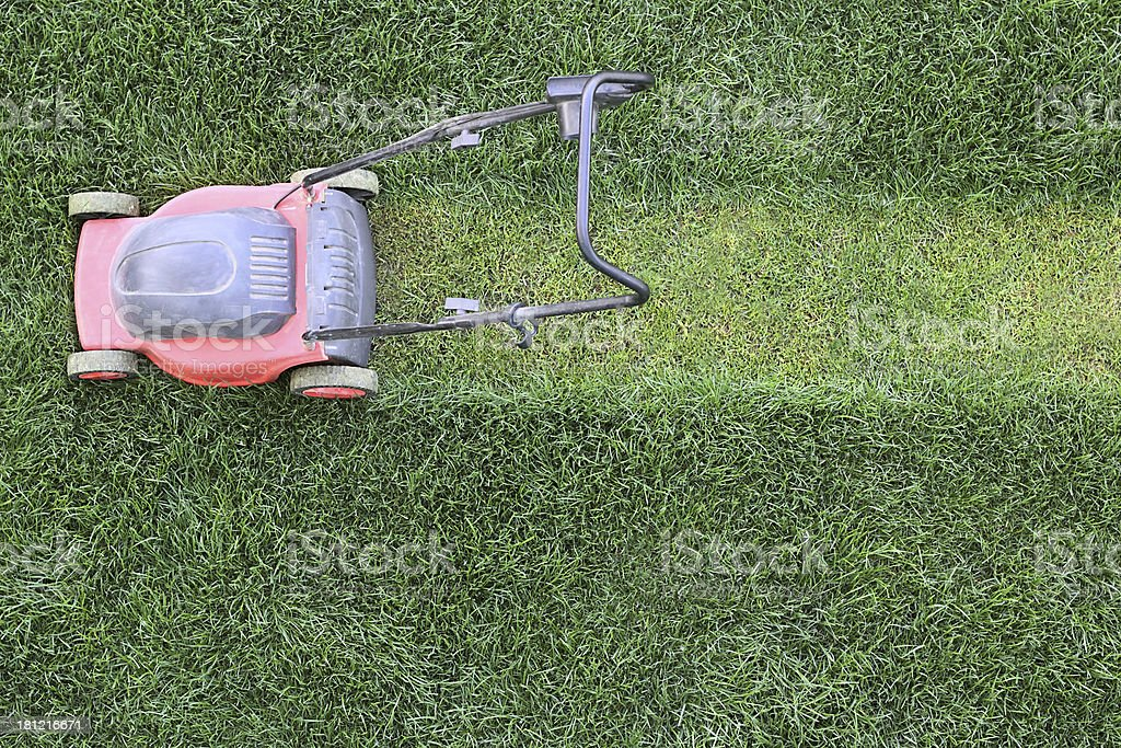 Grass cutter at the lawn stock photo