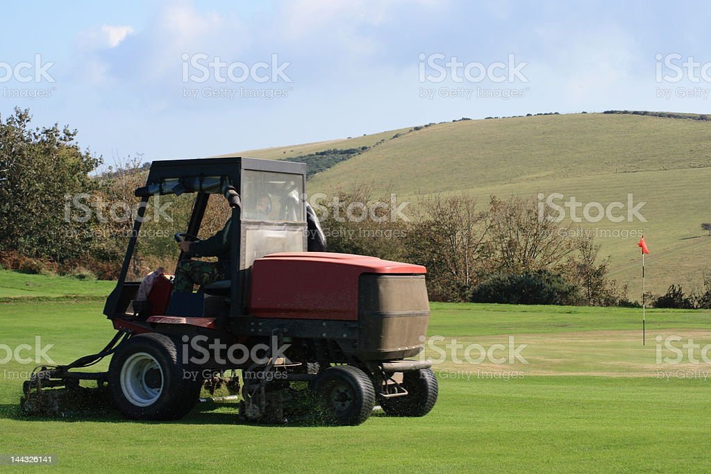 Grass cutting machinery on a golf course royalty-free stock photo