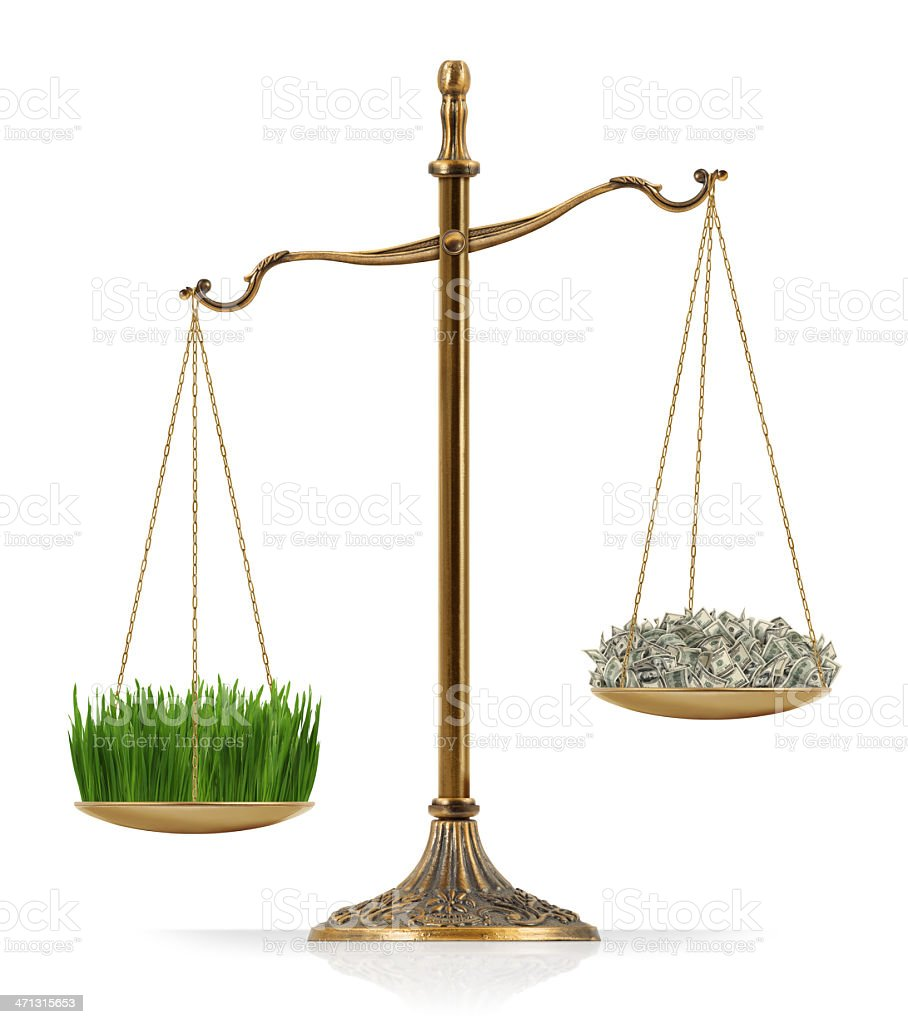 "Grass Heavier Than Money There is green grass at the one side of ""Scales of Justice"" while there is money on the other side. In this version, green grass seems heavier than money. Isolated on white background. Agricultural Field Stock Photo"