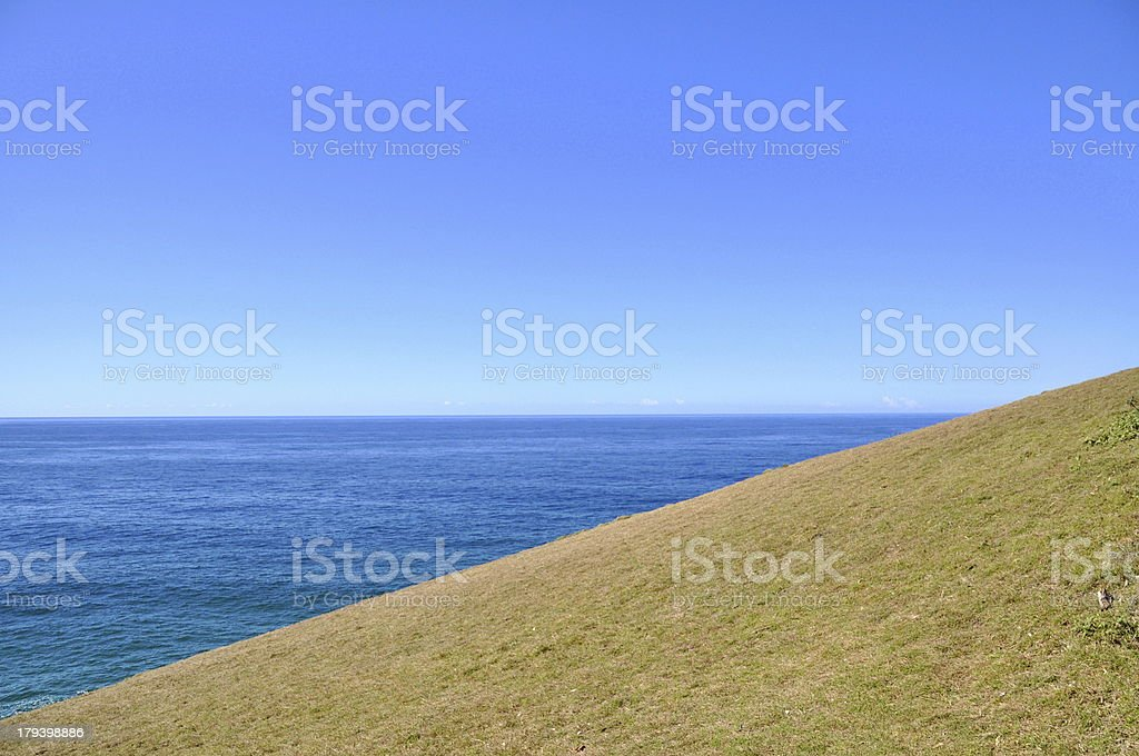 Grass Hill and Blue Sky Horizon royalty-free stock photo