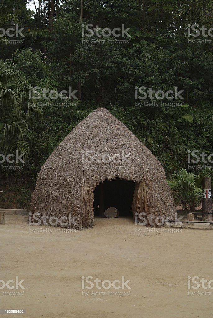 Grass home constructed by Oca Indians stock photo