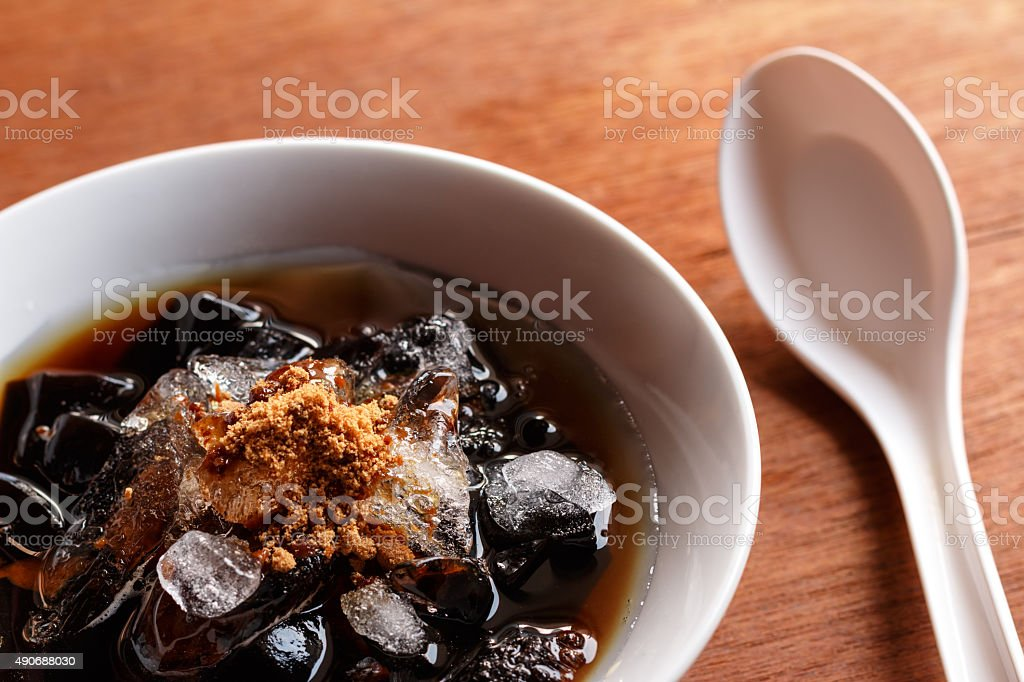 grass jelly dessert  in syrup with ice and brown sugar. stock photo