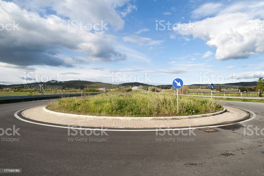 Grass on traffic roundabout stock photo