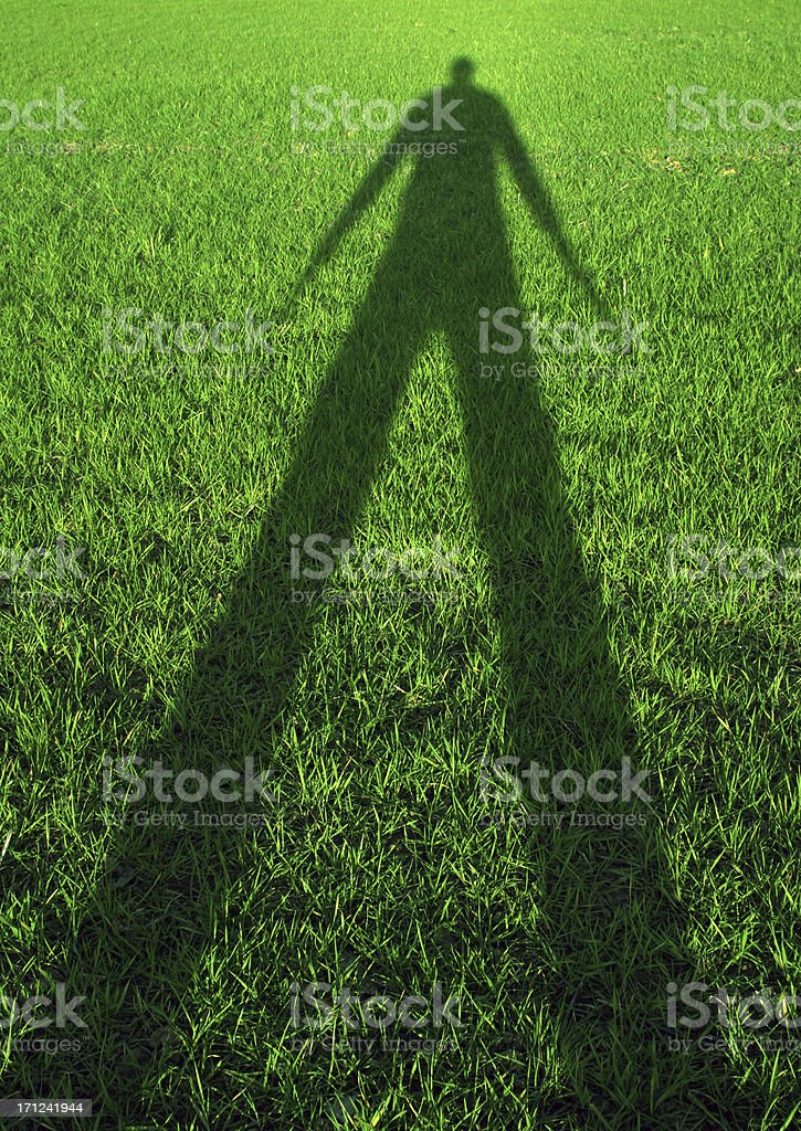 Grass shadow - arms down royalty-free stock photo