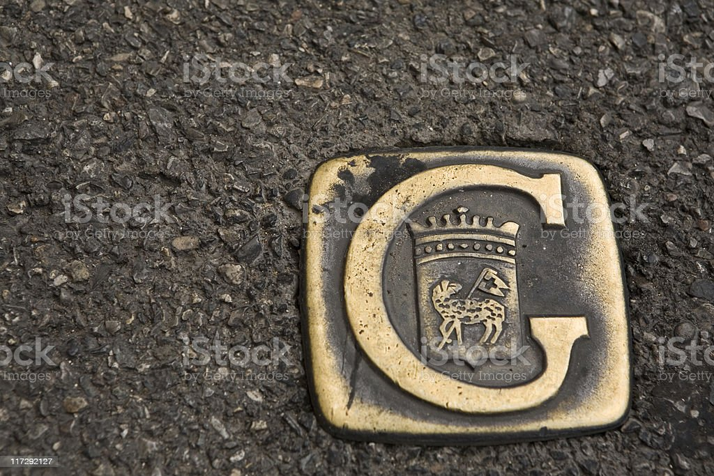Grasse's official coat of arms in the pavement stock photo