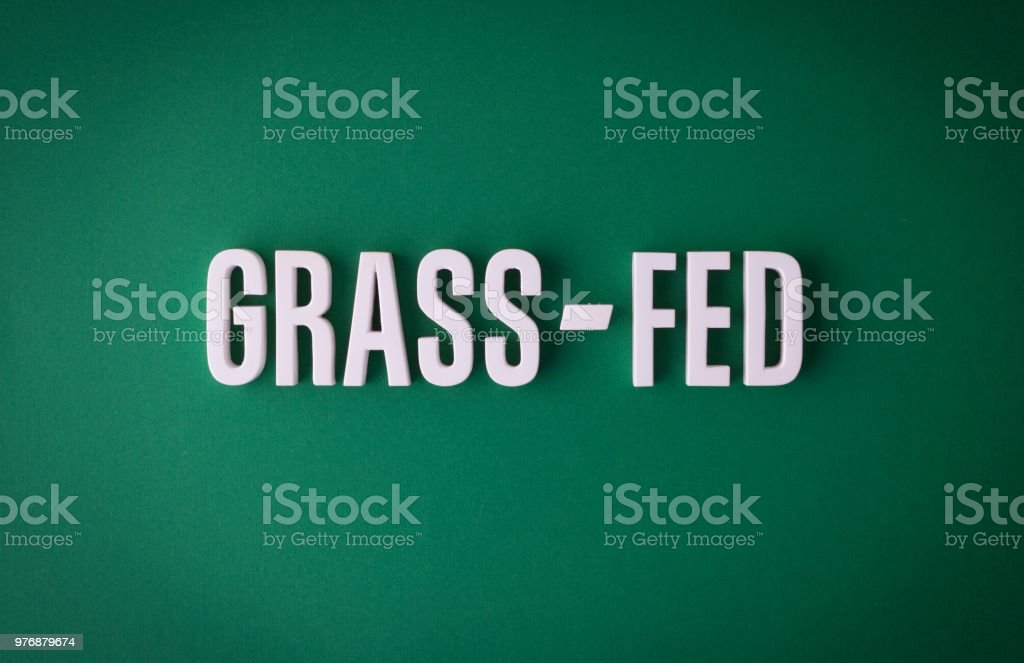 Grass-fed lettering sign stock photo