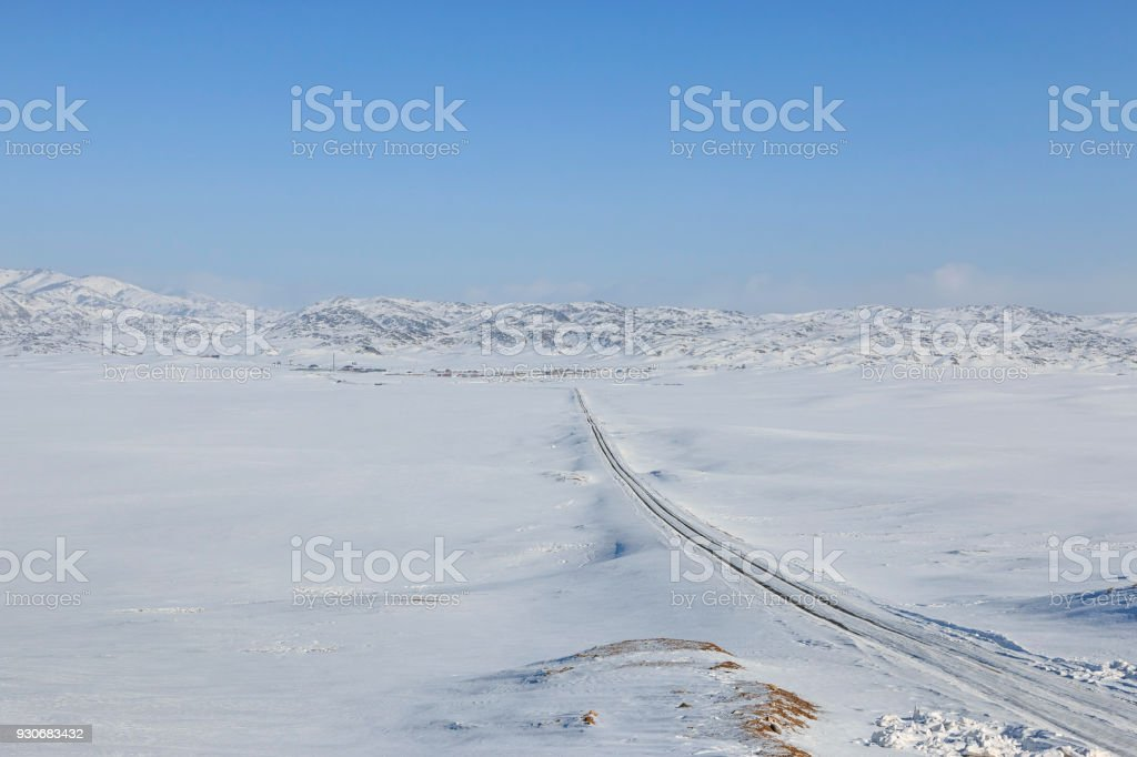 Grassland covered in ice and snow in Xinjiang, northen China stock photo