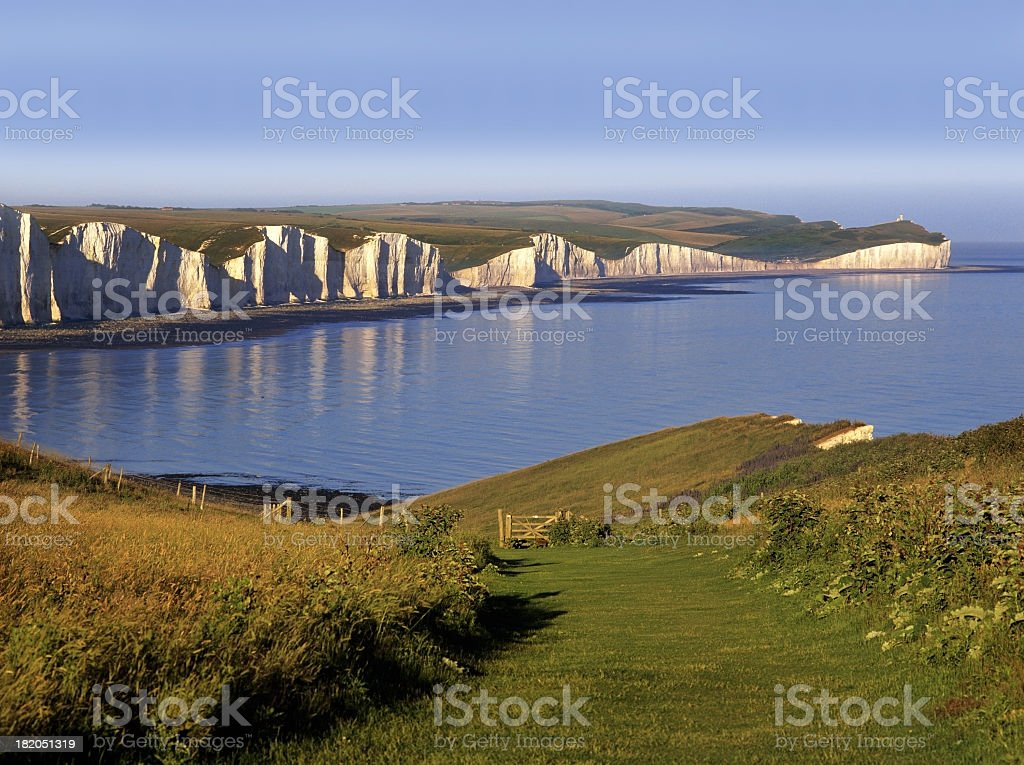 A grassy coastline surrounding the water on three sides stock photo