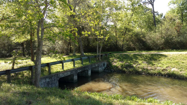 Grassy Culvert Bridge over a Stream stock photo