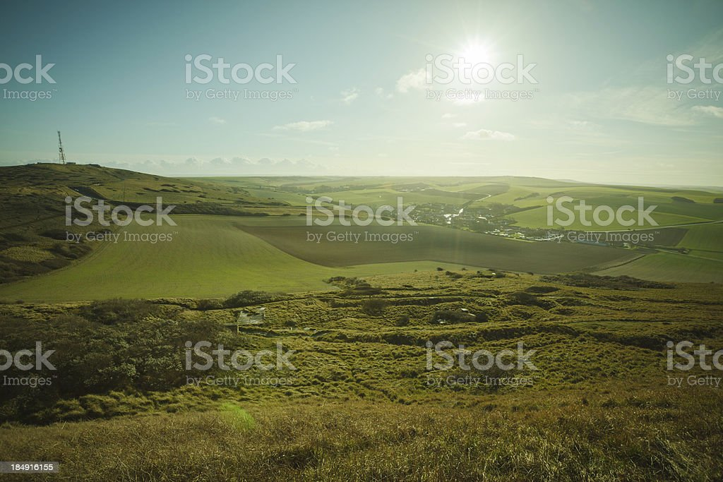 Grassy fields and distant town in northern France stock photo