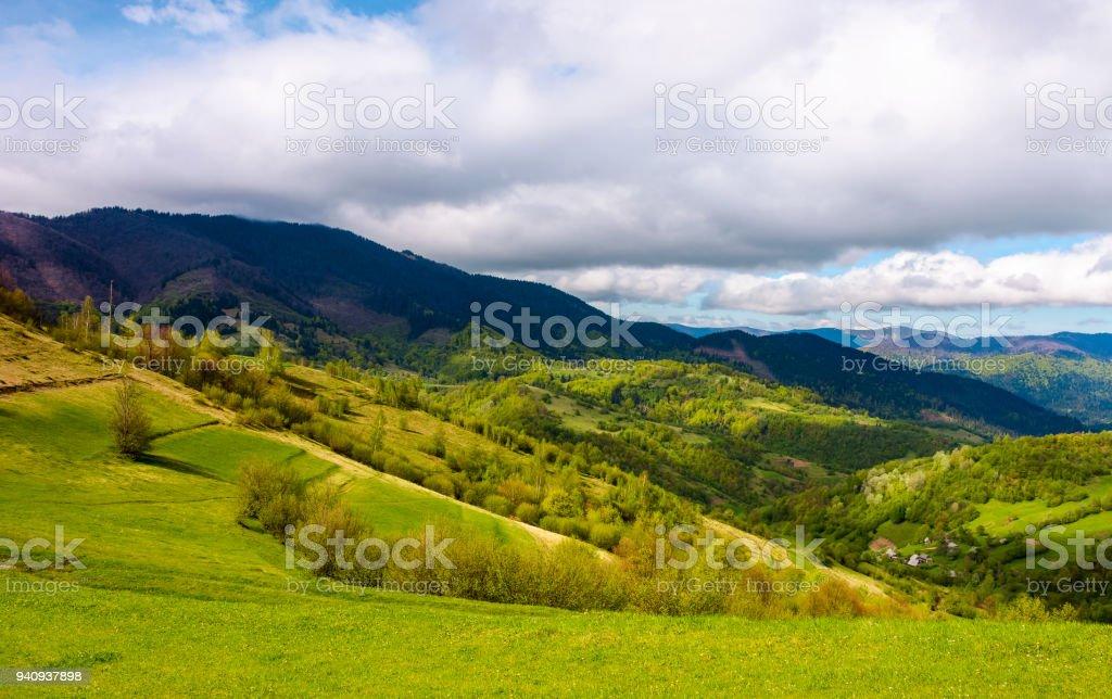 grassy fields in mountainous rural area stock photo