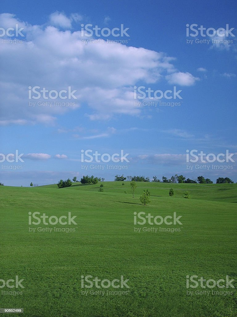 Grassy Hills and Blue Sky stock photo