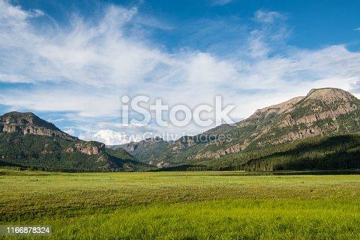 Open fields of grass beneath the Rocky Mountains near Pagosa Springs, Colorado