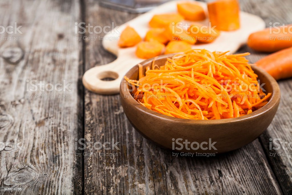 Grate  carrots in a bowl stock photo