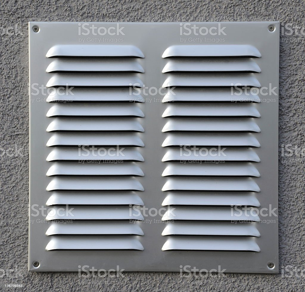 A grate covering a ventilation source stock photo