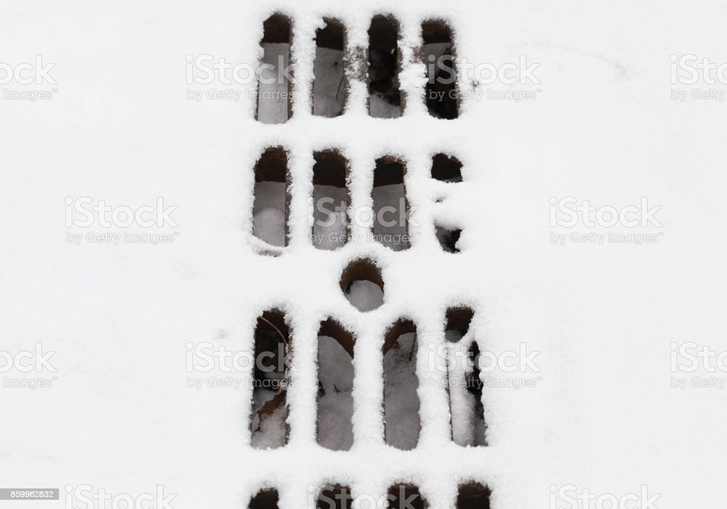 Grate under the snow stock photo