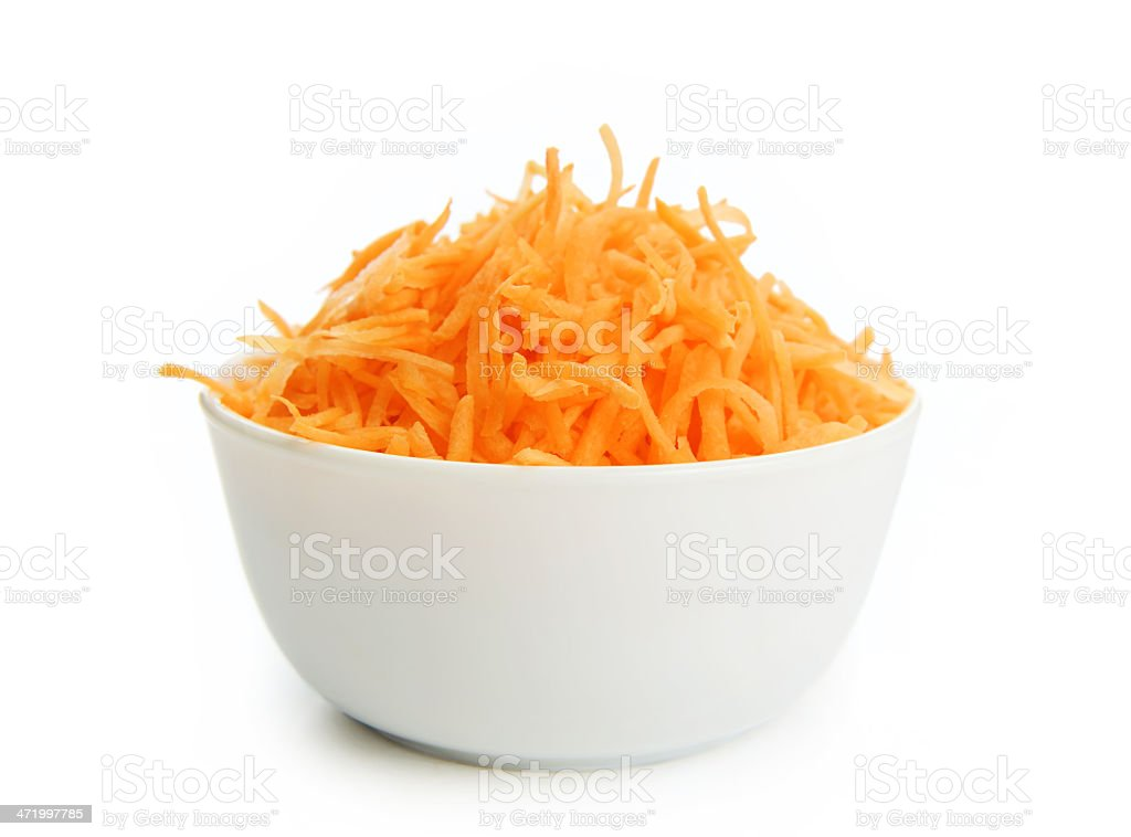 Grated carrots in a cup on white background stock photo