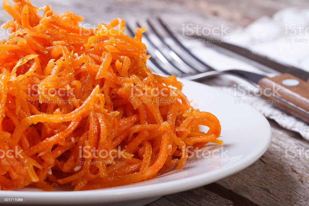 grated carrots with spices Korean. macro stock photo
