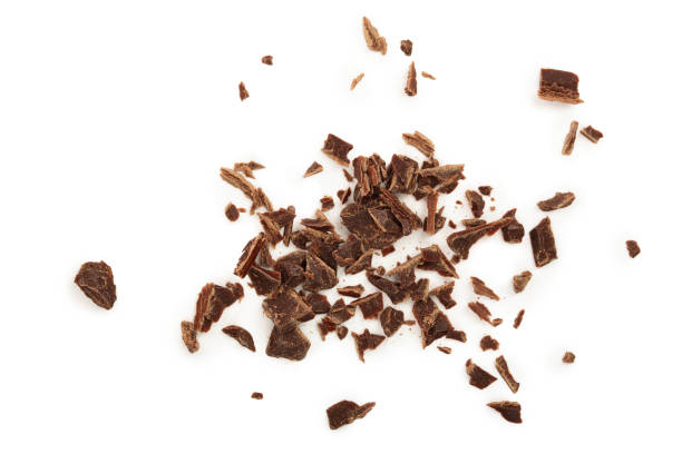 grated chocolate isolated on white background. top view - briciola foto e immagini stock