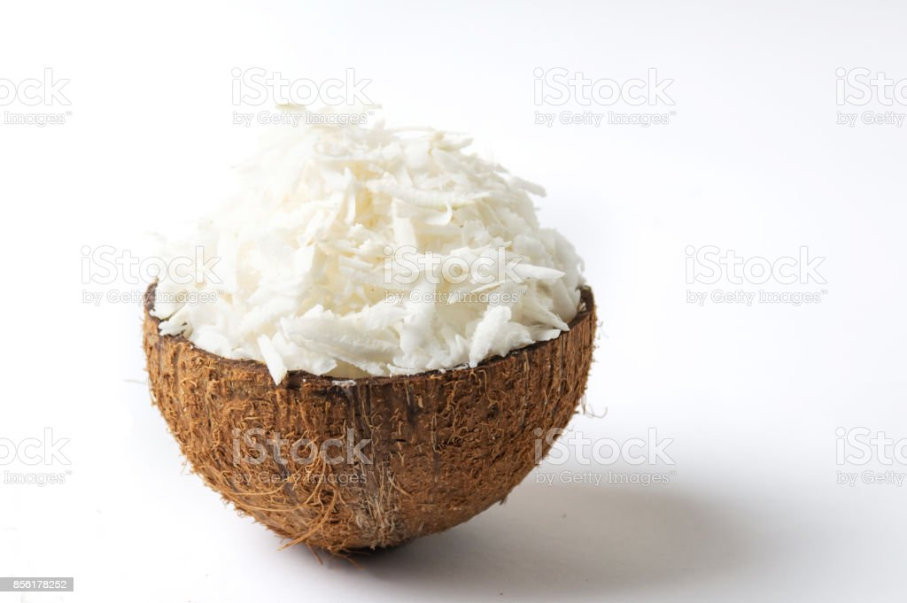 Grated coconut in a natural shell stock photo