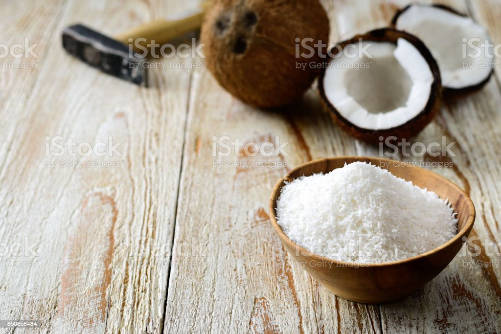 Grated coconut with its shell on background stock photo