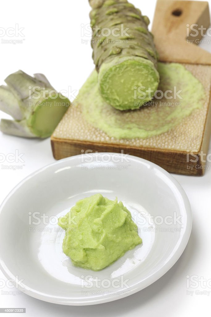 grated fresh wasabii by shark skin grater stock photo