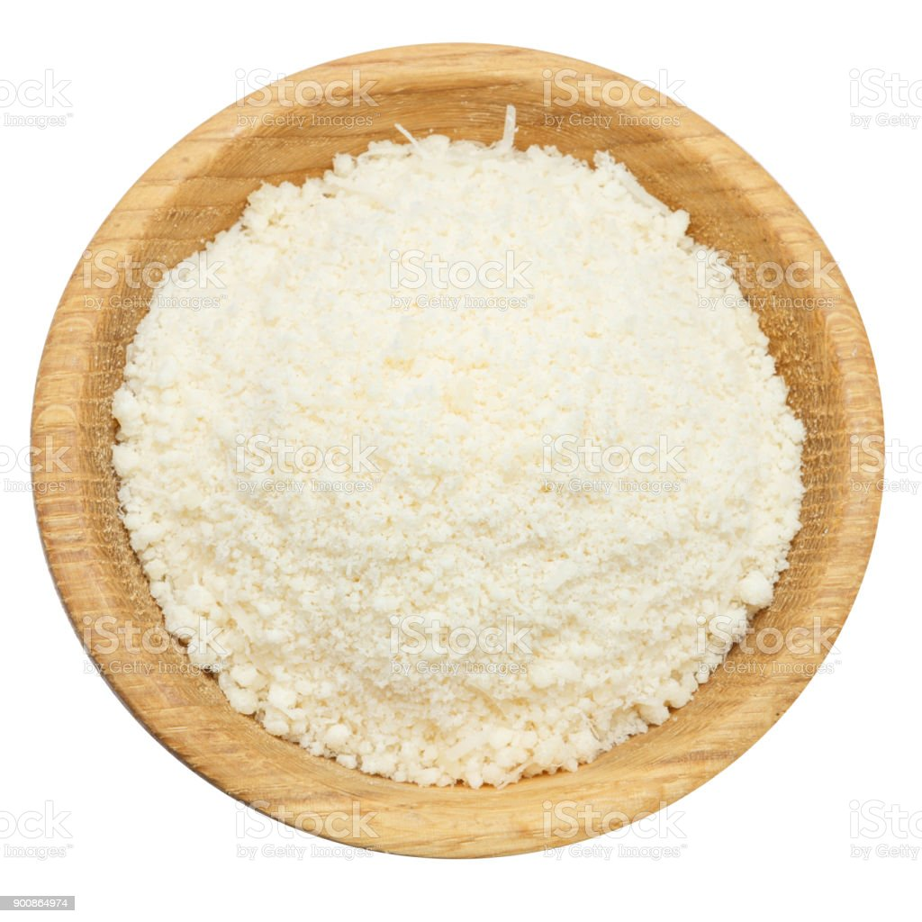 grated Parmesan cheese in wooden bowl on white background stock photo