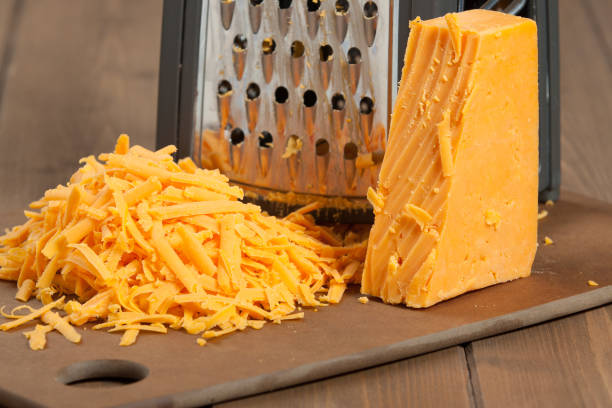 Grated Red Leicester Cheese. Grater. Cooking Ingredient. Grated Red Leicester Cheese. Grater. Cooking Ingredient cheddar cheese stock pictures, royalty-free photos & images