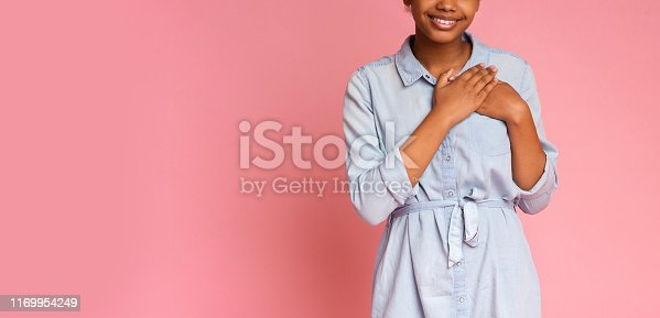 istock Grateful african girl pressing hands to chest 1169954249