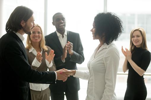 istock Grateful boss handshaking promoting african businesswoman congratulating with career achievement 923041456