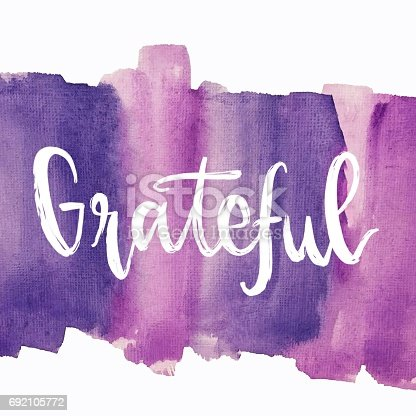 Grateful hand lettering message on purple painted background