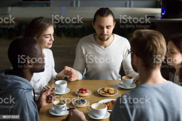 Grateful multiracial friends sitting together at cafe table saying picture id962315532?b=1&k=6&m=962315532&s=612x612&h=dqihu6vevstv6ocef2wh qx92rkgaoxrkjc3gwgfo y=