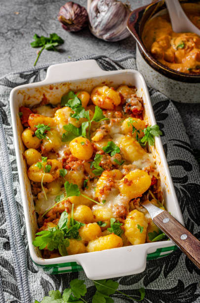 Gratinated gnocchi with cheese stock photo